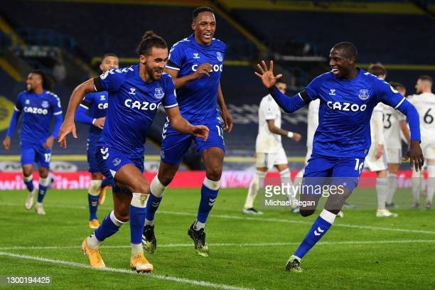 Dominic Calvert-Lewin of Everton celebrates with team mates Abdoulaye Doucoure and Yerry Mina after scoring their side's second goal during the...