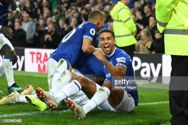 Dominic CalvertLewin of Everton celebrates with team mates after scoring his team's first goal during the Premier League match between Everton FC and...