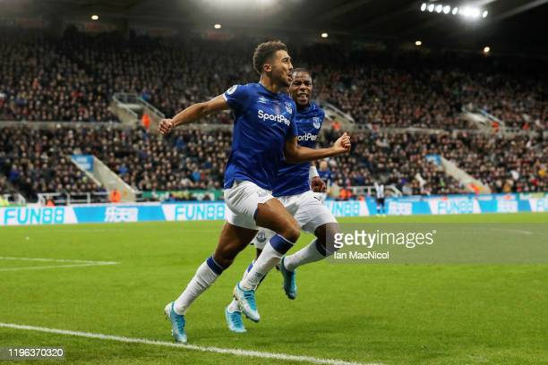 Dominic Calvert-Lewin of Everton celebrates with teammate Djibril Sidibe after scoring his team's second goal during the Premier League match between...