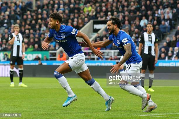 Dominic Calvert-Lewin of Everton celebrates with teammate Theo Walcott of Everton after scoring his team's first goal during the Premier League match...