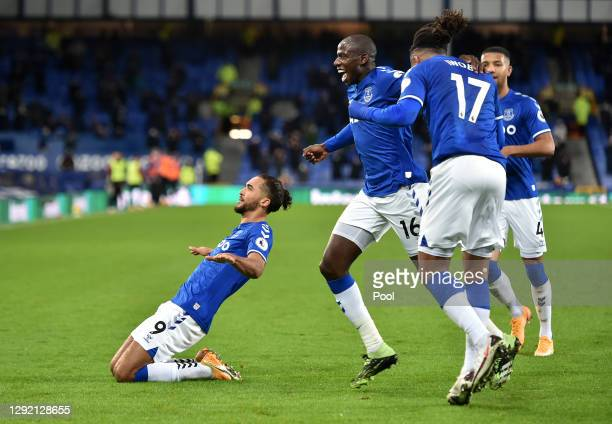 Dominic Calvert-Lewin of Everton celebrates with teammates Abdoulaye Doucoure, Alex Iwobi, and Mason Holgate after their team's first goal, an own...