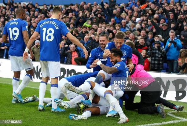 Dominic CalvertLewin of Everton celebrates with teammates after scoring his team's second goal during the Premier League match between Everton FC and...