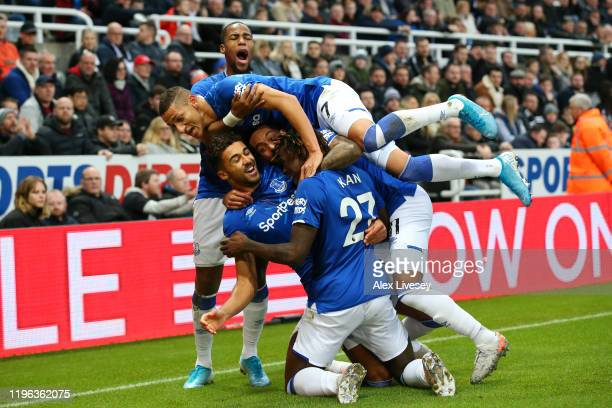 Dominic CalvertLewin of Everton celebrates with teammates after scoring his team's first goal during the Premier League match between Newcastle...