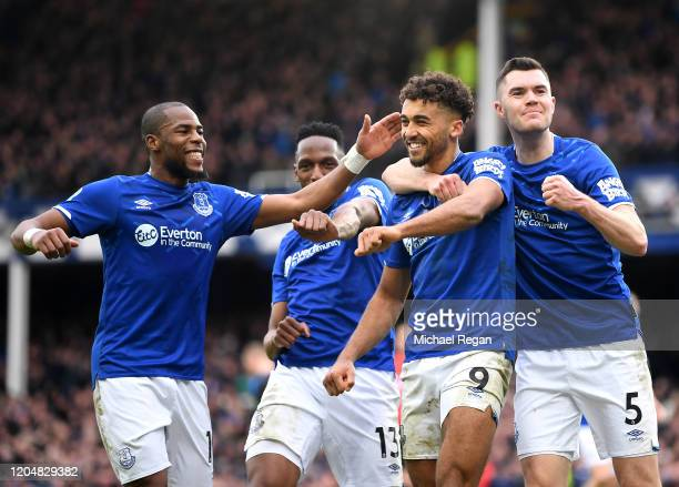 Dominic CalvertLewin of Everton celebrates with teammates after scoring his team's third goal during the Premier League match between Everton FC and...
