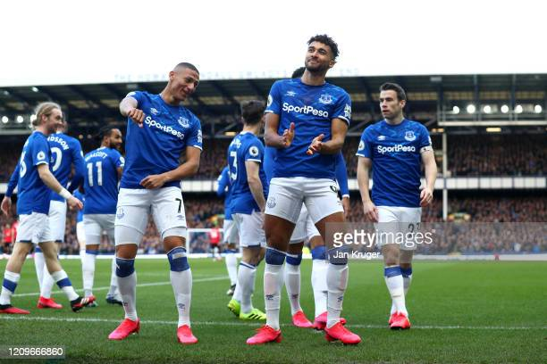 Dominic CalvertLewin of Everton celebrates with teammates after scoring his team's first goal during the Premier League match between Everton FC and...