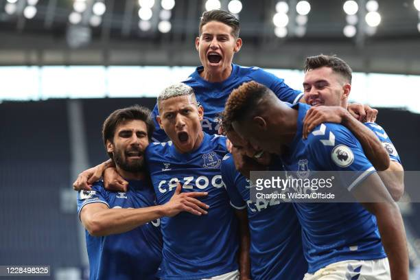 Dominic Calvert-Lewin of Everton celebrates with teammates Andre Gomes , Richarlison , James Rodriguez , Michael Keane and Yerry Mina of Everton...