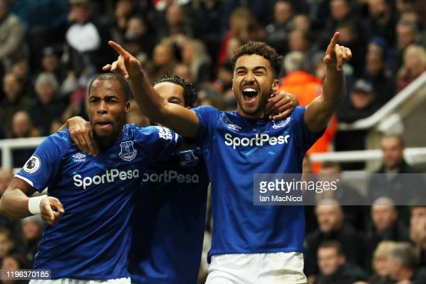 Dominic Calvert-Lewin of Everton celebrates with teammates Djibril Sidibe and Theo Walcott after scoring his team's second goal during the Premier...