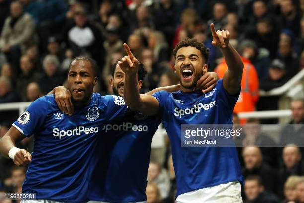 Dominic CalvertLewin of Everton celebrates with teammates Djibril Sidibe and Theo Walcott after scoring his team's second goal during the Premier...