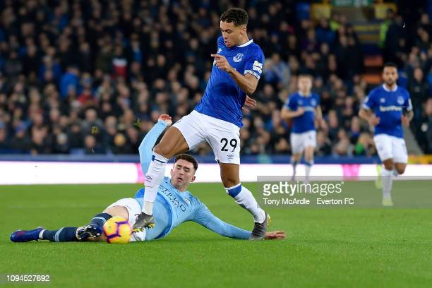 Dominic CalvertLewin of Everton challenges for the ball with Aymeric Laporte during the Premier League match between Everton and Manchester Cit at...