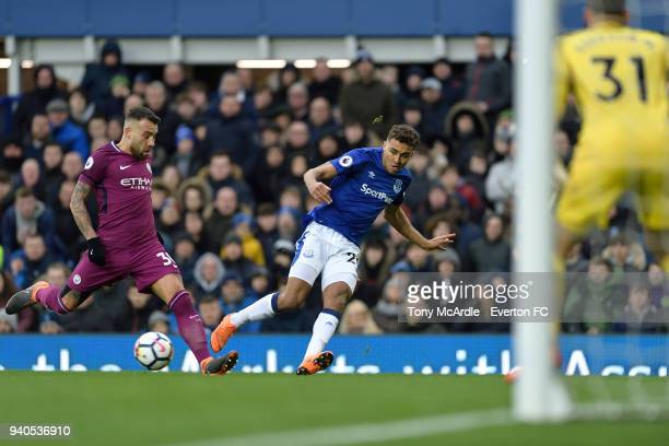 Dominic CalvertLewin of Everton crosses the ball during the Premier League match between Everton and Manchester City at Goodison Park on March 31...