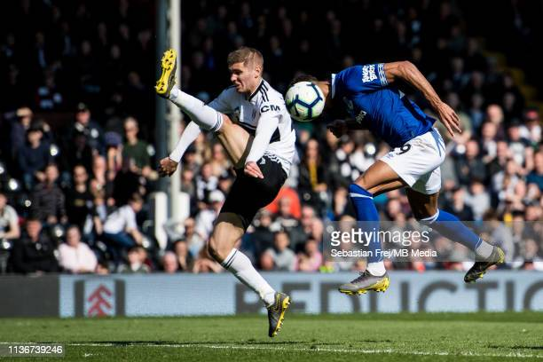 Dominic Calvert-Lewin of Everton FC and Maxime Le Marchand of Fulham FC jump for ball during the Premier League match between Fulham FC and Everton...