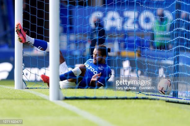 Dominic CalvertLewin of Everton follows the ball into the net as he scores during the PreSeason Friendly match between Everton and Preston North End...