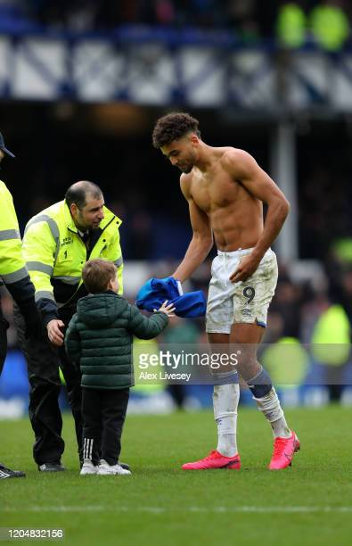 Dominic CalvertLewin of Everton gives his shirt to a young fan during the Premier League match between Everton FC and Crystal Palace at Goodison Park...