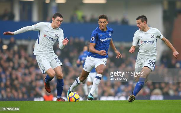 Dominic CalvertLewin of Everton goes between Andreas Christensen and Cesar Azpilicueta of Chelsea outjumps during the Premier League match between...