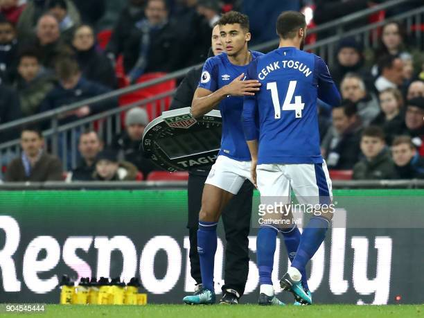 Dominic CalvertLewin of Everton greets Cenk Tosun as he is substituted off during the Premier League match between Tottenham Hotspur and Everton at...