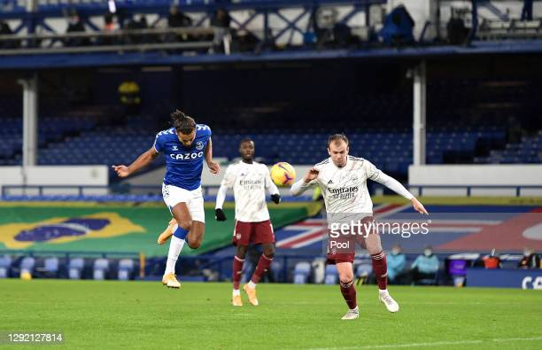 Dominic Calvert-Lewin of Everton headers a shot, which is then deflected in by Rob Holding of Arsenal, for Everton's first goal during the Premier...
