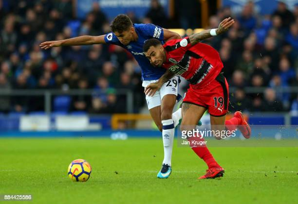 Dominic CalvertLewin of Everton is challenged by Danny Williams of Huddersfield Town during the Premier League match between Everton and Huddersfield...