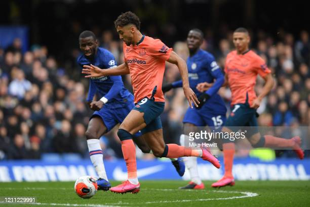 Dominic CalvertLewin of Everton is challenged by from Antonio Rudiger of Chelsea during the Premier League match between Chelsea FC and Everton FC at...