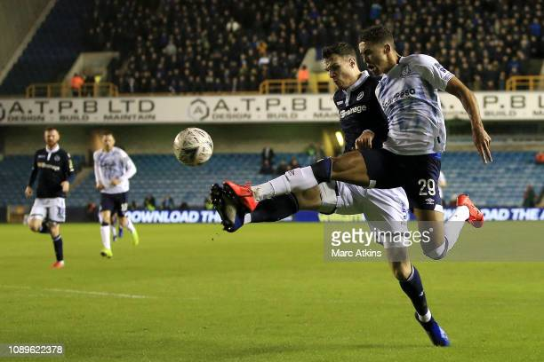 Dominic CalvertLewin of Everton is challenged by Jake Cooper of Millwall during the FA Cup Fourth Round match between Millwall and Everton at The Den...