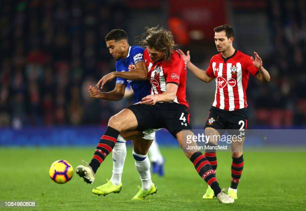 Dominic CalvertLewin of Everton is challenged by Jannik Vestergaard of Sothampton during the Premier League match between Southampton FC and Everton...