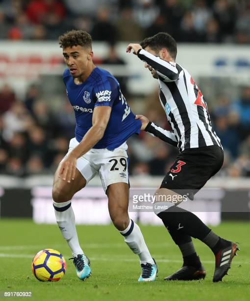 Dominic CalvertLewin of Everton is challenged by Mikel Merino of Newcastle United during the Premier League match between Newcastle United and...
