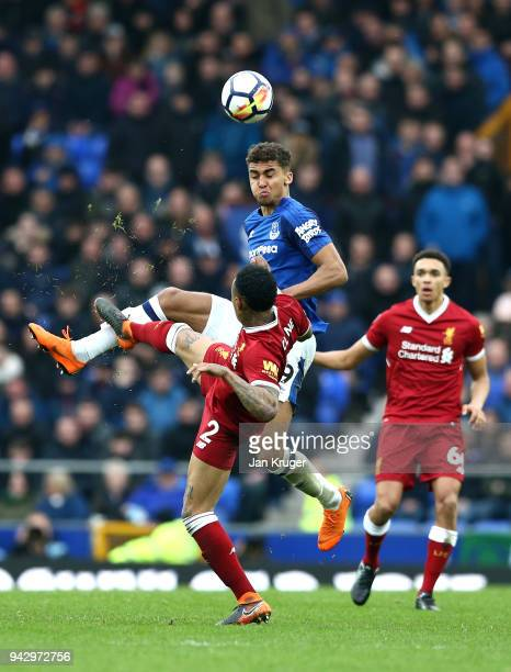 Dominic CalvertLewin of Everton is challenged by Nathaniel Clyne of Liverpool during the Premier League match between Everton and Liverpool at...