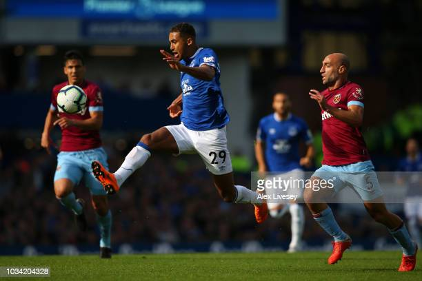 Dominic CalvertLewin of Everton is challenged by Pablo Zabaleta of West Ham United during the Premier League match between Everton FC and West Ham...