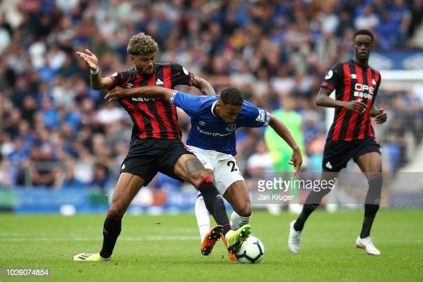 Dominic CalvertLewin of Everton is challenged by Philip Billing of Huddersfield Town during the Premier League match between Everton FC and...