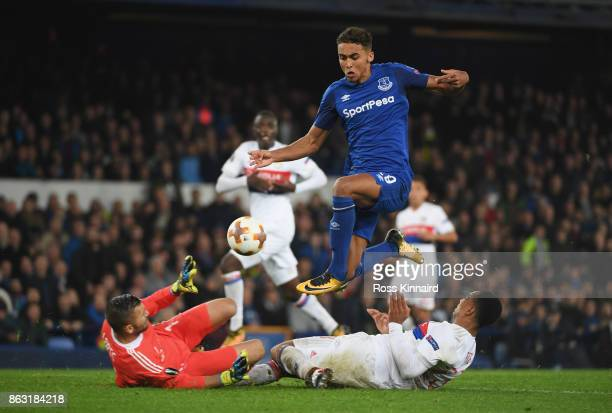 Dominic CalvertLewin of Everton is foiled by Anthony Lopes and Kenny Tete of Lyon during the UEFA Europa League Group E match between Everton FC and...