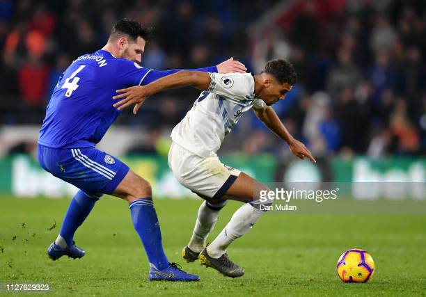 Dominic CalvertLewin of Everton is marshalled by Sean Morrison of Cardiff City during the Premier League match between Cardiff City and Everton FC at...