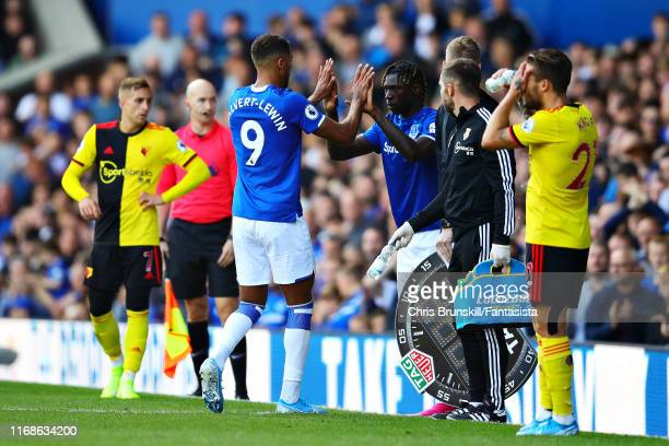 Dominic CalvertLewin of Everton is replaced by teammate Moise Kean as a substitute during the Premier League match between Everton FC and Watford FC...