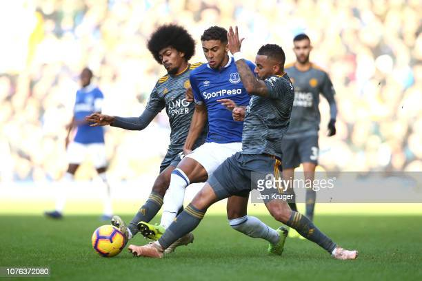 Dominic CalvertLewin of Everton is tackled by Danny Simpson and Hamza Choudhury of Leicester City during the Premier League match between Everton FC...
