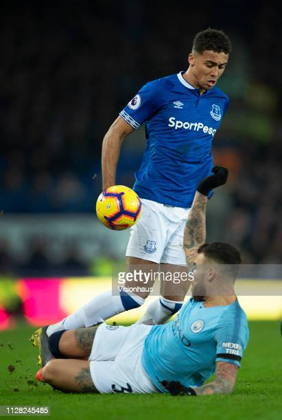 Dominic CalvertLewin of Everton is tackled by Nicolas Otamendi of Manchester City in action during the Premier League match between Everton FC and...