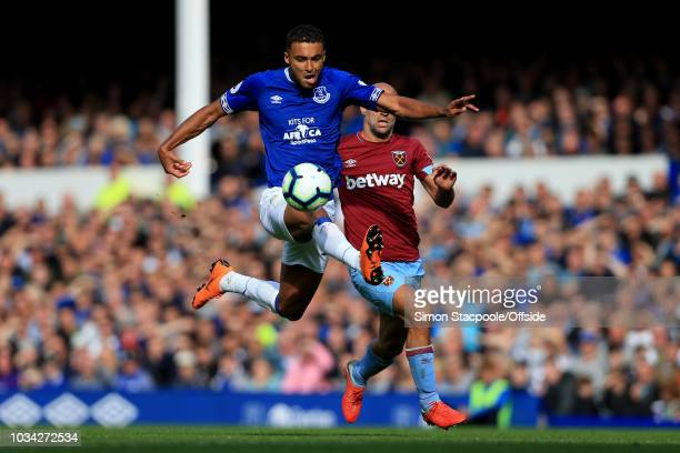 Dominic CalvertLewin of Everton leaps to control the ball ahead of Pablo Zabaleta of West Ham during the Premier League match between Everton and...