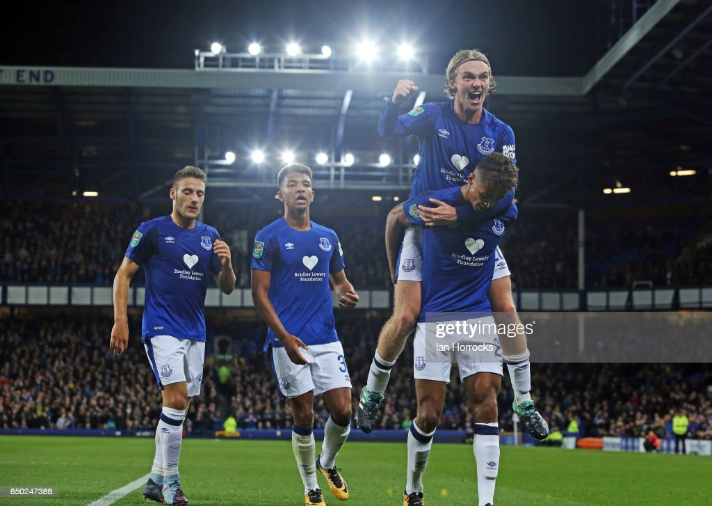 Dominic Calvert-Lewin of Everton of Everton ( bottom R) celebrates scoring the opening goal during the Carabao Cup third round match at Goodison Park on September 20, 2017 in Liverpool, England.