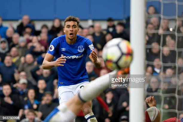 Dominic CalvertLewin of Everton rues a missed Cenk Tosun headed chance on goal during the Premier League match between Everton and Liverpool at...