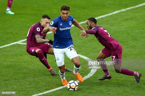 Dominic CalvertLewin of Everton runs with the ball despite challenges by Nicolas Otamendi of Manchester City and Raheem Sterling of Manchester City...