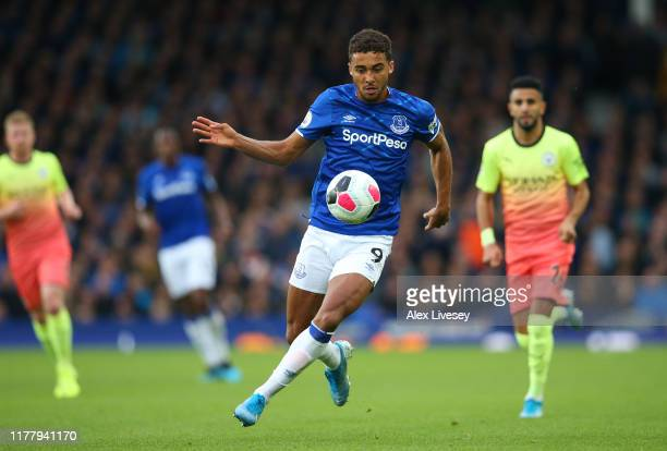 Dominic CalvertLewin of Everton runs with the ball during the Premier League match between Everton FC and Manchester City at Goodison Park on...