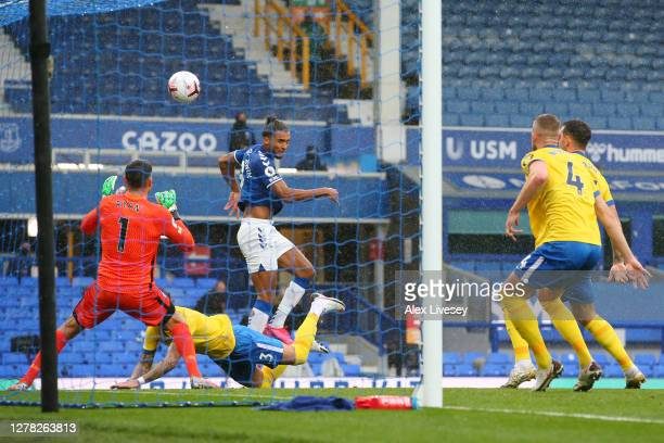 Dominic Calvert-Lewin of Everton scores his sides first goal during the Premier League match between Everton and Brighton & Hove Albion at Goodison...