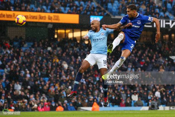 Dominic Calvert-Lewin of Everton scores his team's first goal as he is challenged by Fabian Delph of Manchester City during the Premier League match...