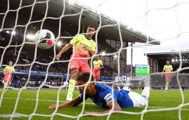 Dominic CalvertLewin of Everton scores his team's first goal during the Premier League match between Everton FC and Manchester City at Goodison Park...