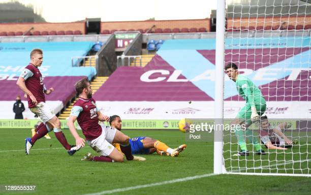 Dominic Calvert-Lewin of Everton scores his team's first goal past Nick Pope of Burnley during the Premier League match between Burnley and Everton...