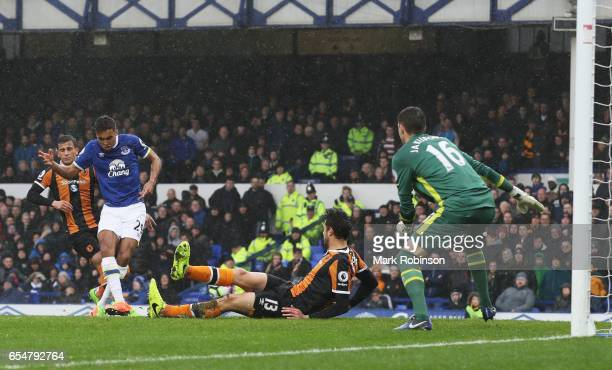 Dominic CalvertLewin of Everton scores their first goal during the Premier League match between Everton and Hull City at Goodison Park on March 18...