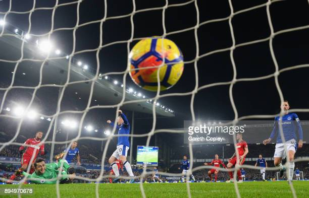 Dominic CalvertLewin of Everton scores their first goal past Lukasz Fabianski of Swansea City with team matesduring the Premier League match between...