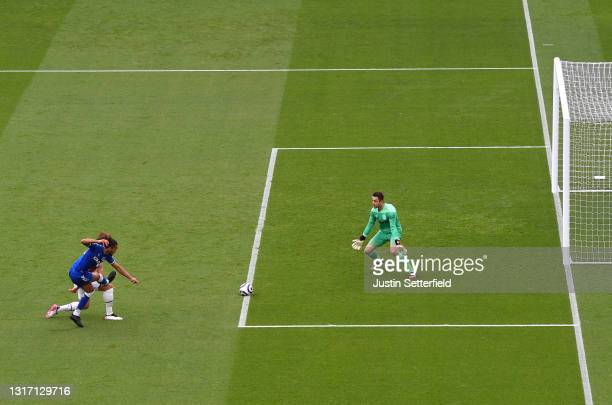 Dominic Calvert-Lewin of Everton scores their side's first goal past Lukasz Fabianski of West Ham United during the Premier League match between West...