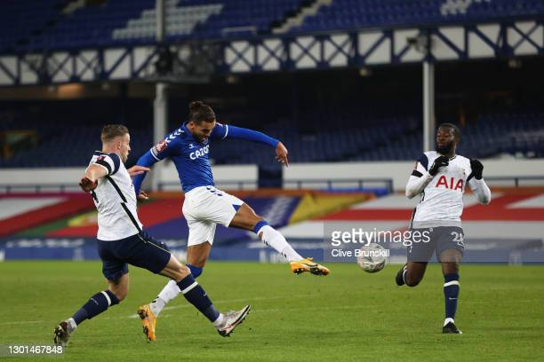 Dominic Calvert-Lewin of Everton scores their side's first goal whilst under pressure from Toby Alderweireld and Tanguy Ndombele of Tottenham Hotspur...