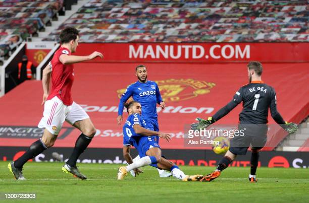 Dominic Calvert-Lewin of Everton scores their team's third goal past David De Gea of Manchester United during the Premier League match between...