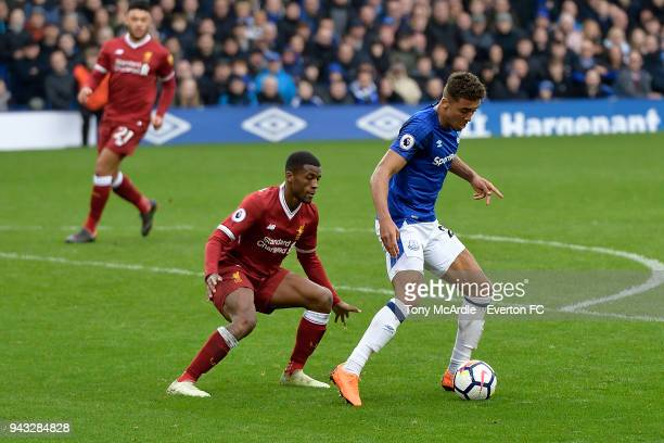 Dominic CalvertLewin of Everton shields the ball from Georginio Wijnaldum of Liverpool challenge for the ball during the Premier League match between...