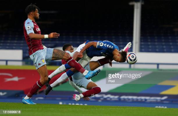Dominic Calvert-Lewin of Everton shoots and misses whilst under pressure from Ezri Konsa of Aston Villa during the Premier League match between...