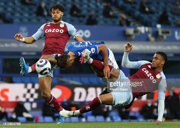 Dominic Calvert-Lewin of Everton shoots and misses whilst under pressure from Ezri Konsa of Aston Villa and Tyrone Mings of Aston Villa during the...